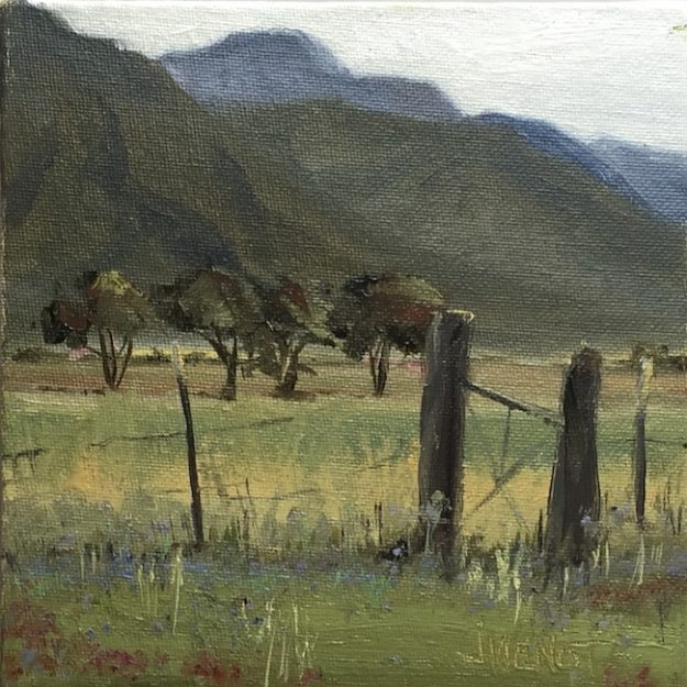 Oil painting of the wildflowers and fenced meadow at Overland Sheepskin Co, north of Taos, NM